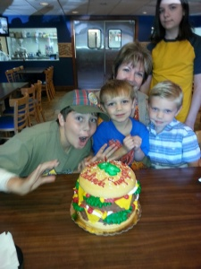Belinda and the boyz admiring her Hamburger Cake!